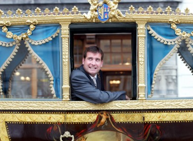 Royston Brady boards the lord mayor's state coach to travel to the Dublin Horse Show in 2003.