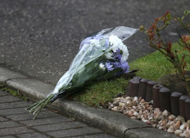 Flowers outside a house in Dalgety Bay in Fife, where the boys died.