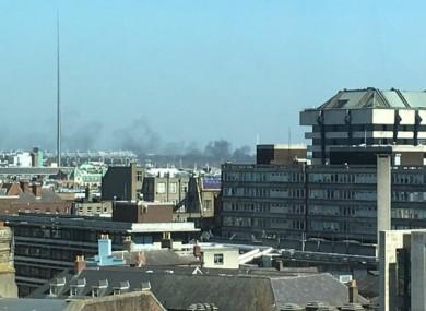 Black smoke rises across the northside of Dublin city.