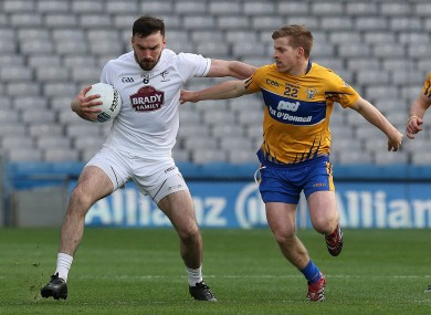 Kildare's Fergal Conway and Thomas Downes of Clare.