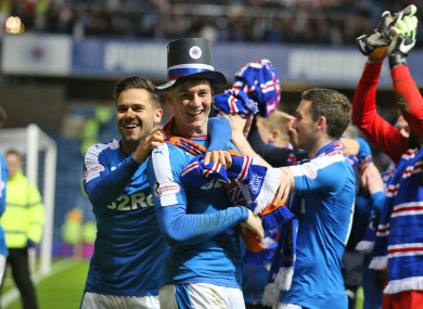 Rangers players celebrate at full-time.