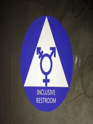 A new sticker designates a gender neutral bathroom at Nathan Hale high school in Seattle.