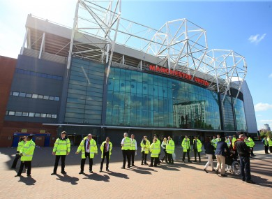 Security cordon around Old Trafford after the game is abandoned during the Barclays Premier League match at Old Trafford.