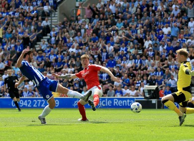 Grigg: 25 league goals helped Wigan secure promotion back to the Championship.