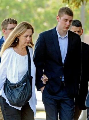 Brock Turner, right, makes his way into the Santa Clara Superior Courthouse in Palo Alto, California.