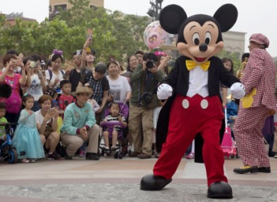 Mickey Mouse entertains visitors on the opening day of the Disney Resort in Shanghai, China.