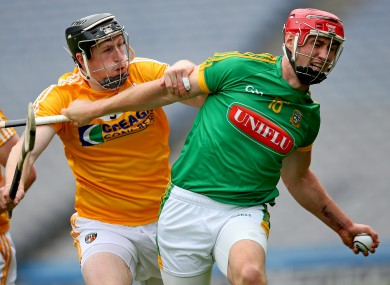 Meath's James Toher with Tony McCloskey of Antrim
