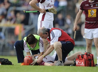 Joe Canning receives treatment after the incident.