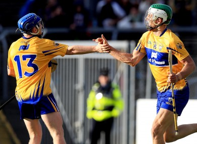 Aaron Shanagher celebrates scoring Clare's fourth goal with Podge Collins