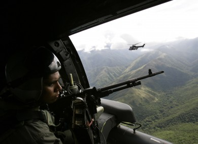 Venezuelan army helicopters fly over the Sierra de Perija national park, west of Venezuelan capital Caracas, where poppy and marijuana plants are often discovered