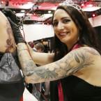 French artist Loren Quenard tattooing Caroline Ansart. <span class=