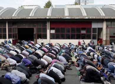 File: French Muslims attend Friday prayers at a disused former fire station converted into a prayer hall near Paris.