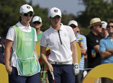 Maguire, 21, has twin sister Lisa on the bag for her this week.