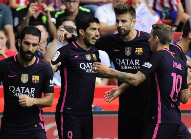 Barcelona celebrate a goal at Sporting Gijon