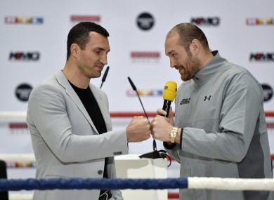 In this 28 April, 2016 file photo, Britain's heavyweight world boxing champion Tyson Fury, right, and challenger Wladimir Klitschko of Ukraine, joke around during a press conference in Cologne.
