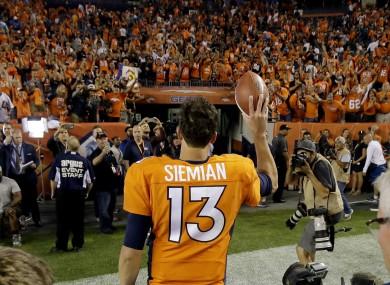 Denver Broncos quarterback Trevor Siemian (13) waves to fans as he leaves the field.