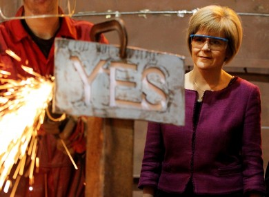 Nicola Sturgeon watching an apprentice manufacturing a steel 'Yes' sign in September 2014.