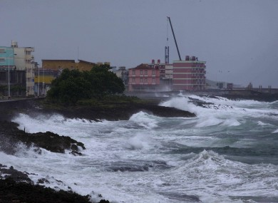 Waves caused by Hurricane Matthew impact on the malecon in Baracoa, Cuba, earlier today.