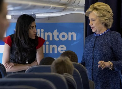 File photo of Democratic presidential candidate Hillary Clinton speaking with senior aide Huma Abedin.