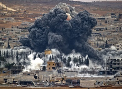 Smoke rises from the Syrian city of Kobani, following an airstrike by the US led coalition. (File photo)