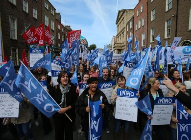 Nurses take part in a pay restoration protest at Leinster House last month.
