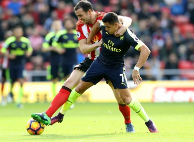 John O'Shea battles for the ball with Arsenal goal scorer Alexis Sanchez.