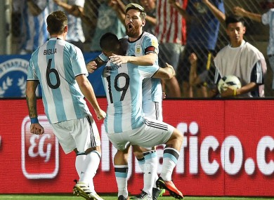Argentina star Lionel Messi is hugged by team-mates.
