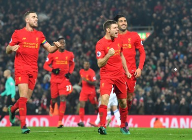 Liverpool's James Milner celebrates scoring his side's second goal.