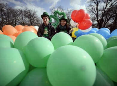 A couple poses during the St Patrick's Day parade in Bucharest, Romania.