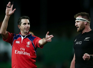 Referee Craig Joubert and All Blacks captain Kieran Read.