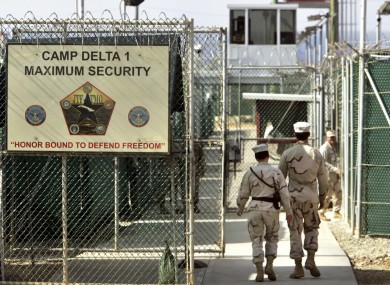 US military guards walk within Camp Delta military-run prison, at the Guantanamo Bay US Naval Base, Cuba.
