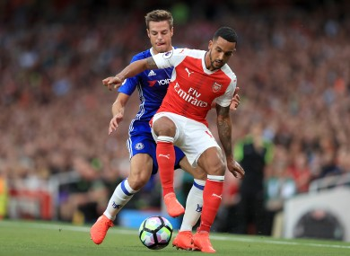 Chelsea's Cesar Azpilicueta (left) and Arsenal's Theo Walcott battle for the ball in the match between the two sides earlier this season.