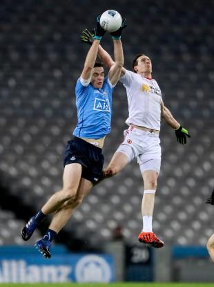 Dublin's Brian Fenton and Tyrone's Colm Cavanagh rise for the ball.