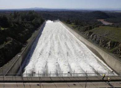 Water flows down Oroville Dam's main spillway.