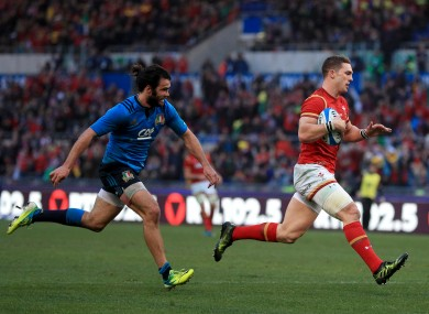 George North runs in to score Wales' third try.