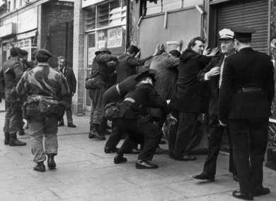 File photo: British soldiers searching people in Shankill Road, Belfast in October 1969.