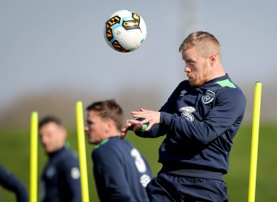 Daryl Horgan heads the ball during yesterday's training session.