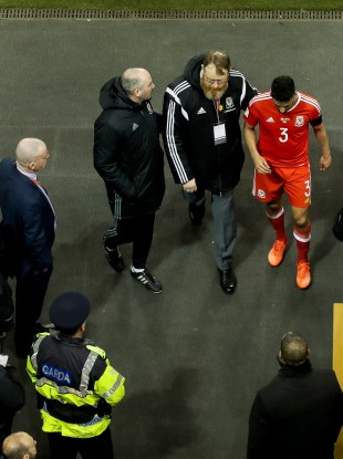Wales' Neil Taylor leaves the field after being red carded.