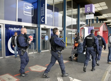 Officers walking near Orly Airport on Saturday.