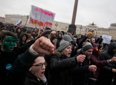Opposition supporters participate in an anti-corruption rally in central Saint Petersburg yesterday.