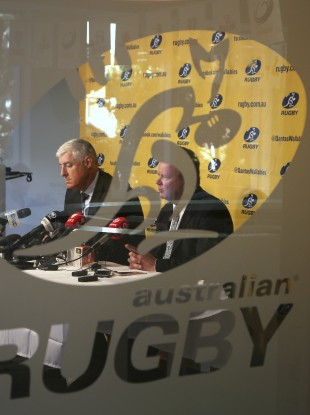 Australian Rugby Union Chairman Cameron Clyne, left, and CEO Bill Pulver discuss how Super Rugby is to be reduced from 18 to 15 teams next season.