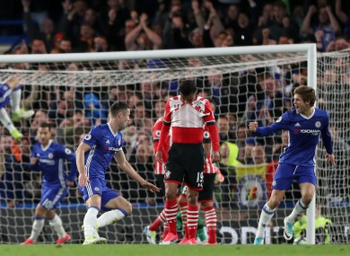 Chelsea's Gary Cahill (centre) scores his side's second goal of the game.