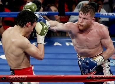 Canelo Alvarez, right, of Mexico, hits Julio Cesar Chavez Jr.