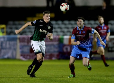 Bray's Anto Flood in action against Drogheda's Ciaran McGuigan.