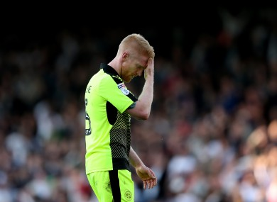 McShane walks off the pitch after his red card.
