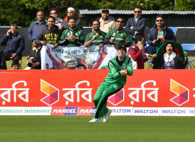 George Dockrell takes a boundary catch to dismiss Sabbir Rahman