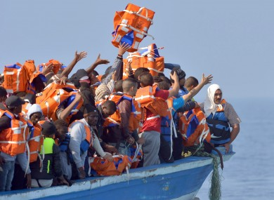 File image: Migrants stranded on a boat off the Libyan coast in 2015.