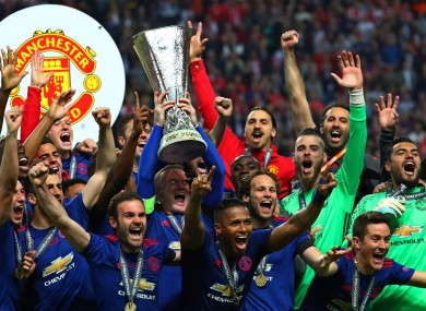 Manchester United players celebrate their Europa League triumph.