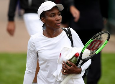 Venus Williams makes her way to the practice courts during a preview day at the The All England Lawn Tennis and Croquet Club, London.