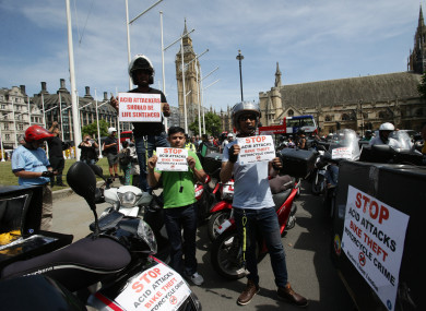 Food delivery riders demonstrate in Parliament Square.